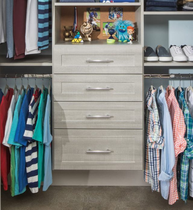 Reach in closet filled with clothing and other accessories