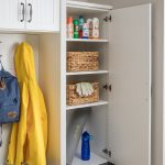 Entry way closet with cabinet open for personal belongings