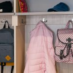 Inspired Closets Closet with Backpacks and a Coat hanging up