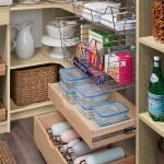 Pull out drawers and baskets in a custom pantry from Inspired Closets