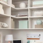 White custom built home office with corner shelving from Inspired Closets