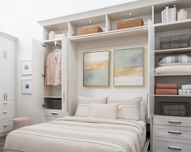 White murphy bed with hidden hanging shelving