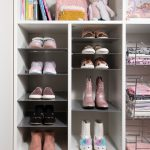 White little girls reach in closet with slanted shoe storage in Las Vegas, NV