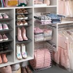 White little girls reach in closet pull out baskets for storage in Las Vegas, NV