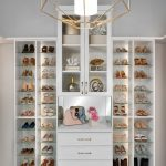 Custom boutique closet in houghton with built-in shelving and adjustable shoe storage and beautiful chandler