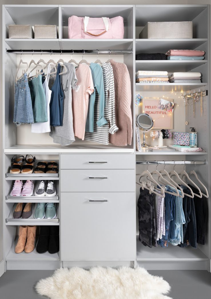 Teen girls closet with slanted shoe shelves and pull out hamper