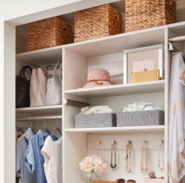 Women's white reach-in closet with shoe shelves and drawers from Inspired Closets