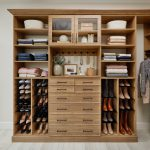 Women's armoire for walk-in closet with drawers and shelves from Inspired Closets