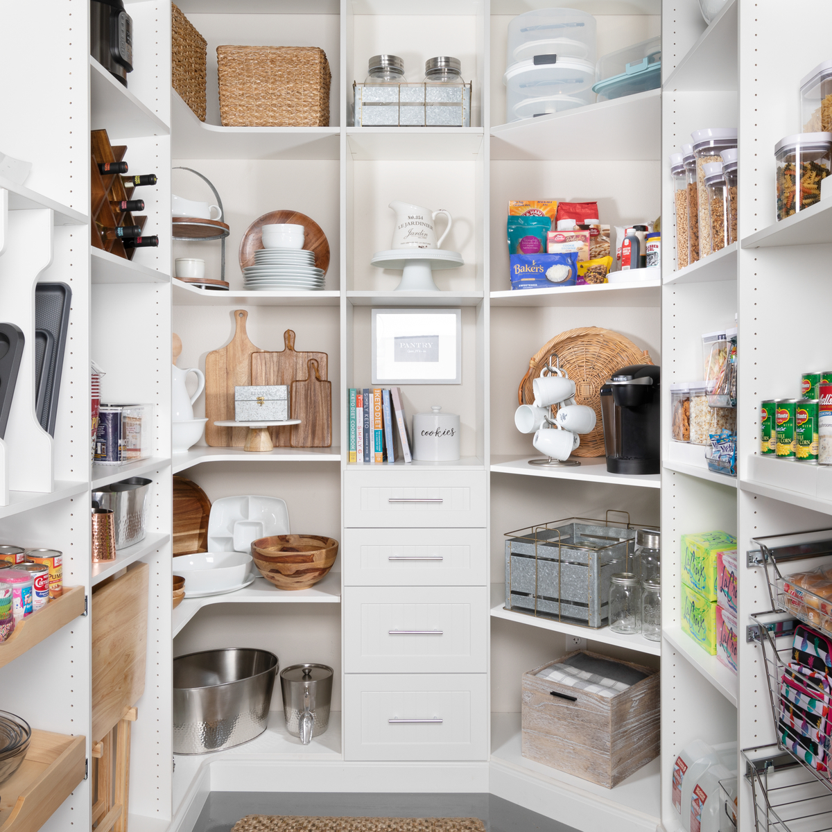 Custom white pantry with drawers and lots of shelves