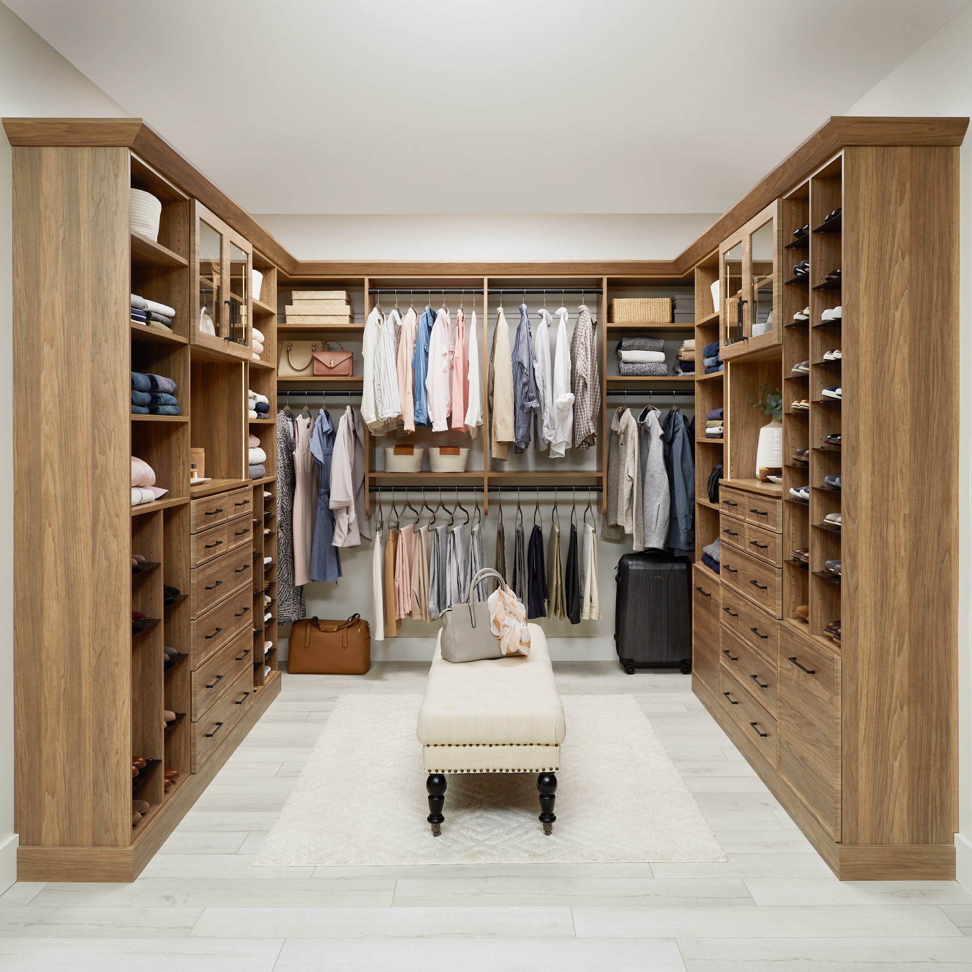 Natural wood brown walk-in closet with lighting