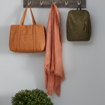 Custom hook storage for garage entryway from Inspired Closets