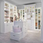 Custom white boutique closet with island and seating station from Inspired Closet
