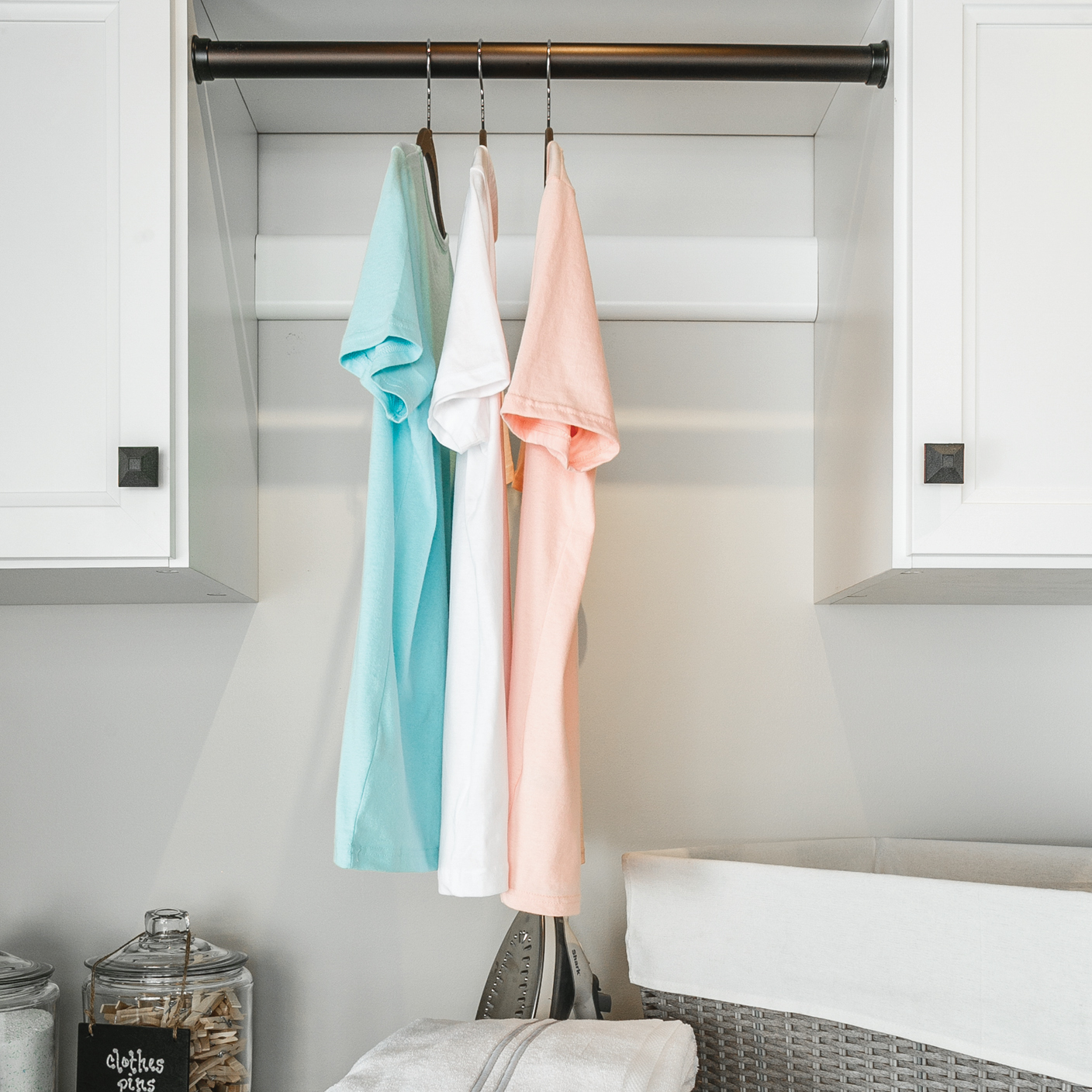 hanging storage for a custom laundry room from Inspired Closets
