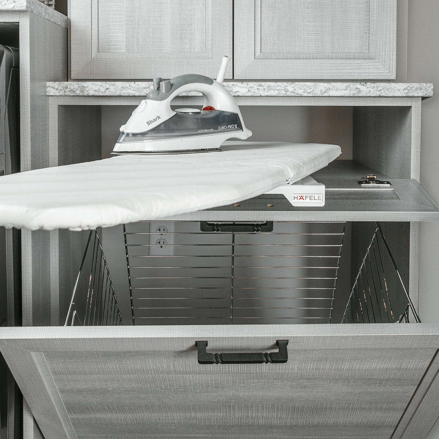 Pull out ironing board and hamper solutions from Inspired Closets