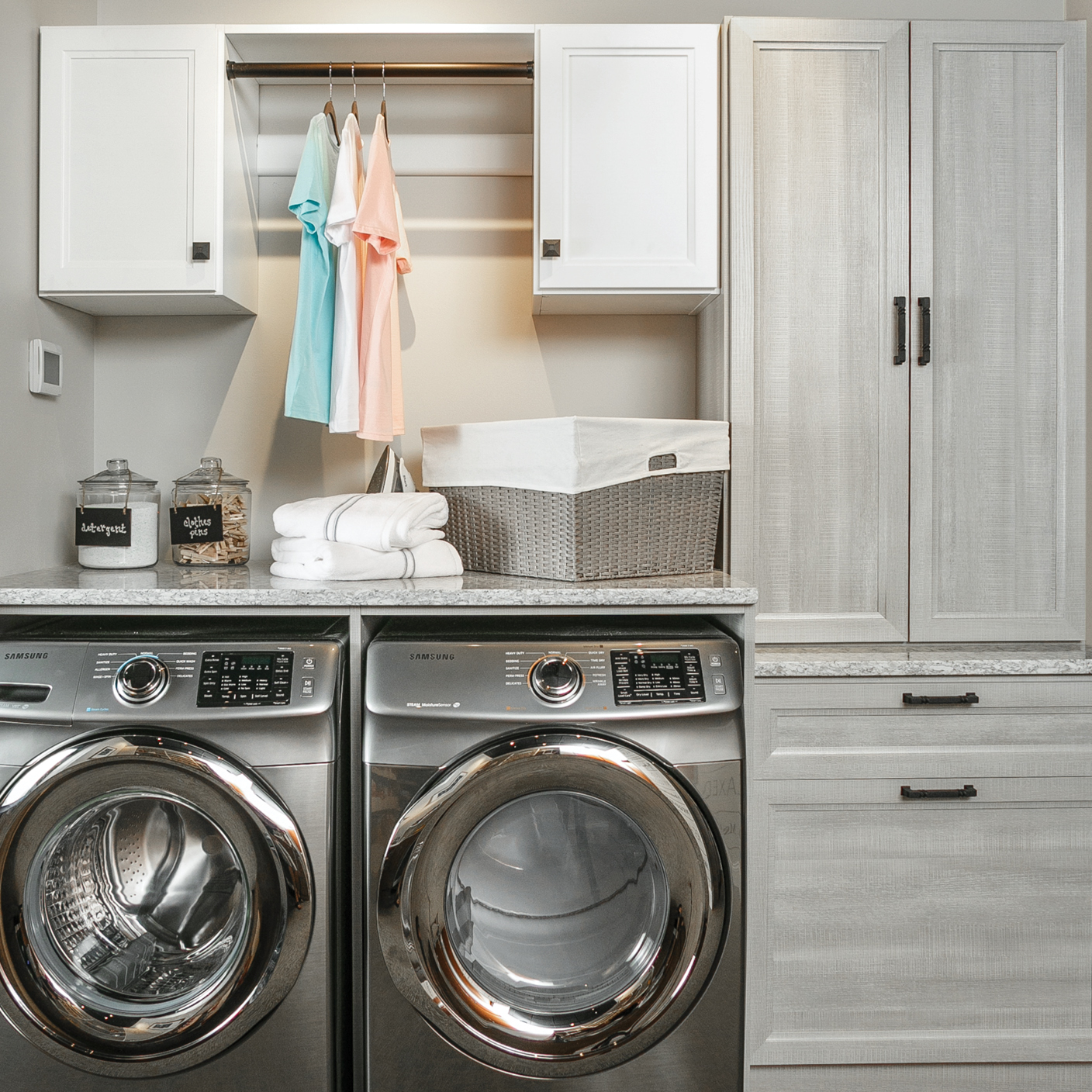 Laundry room storage solutions with hanging rod from Inspired closets