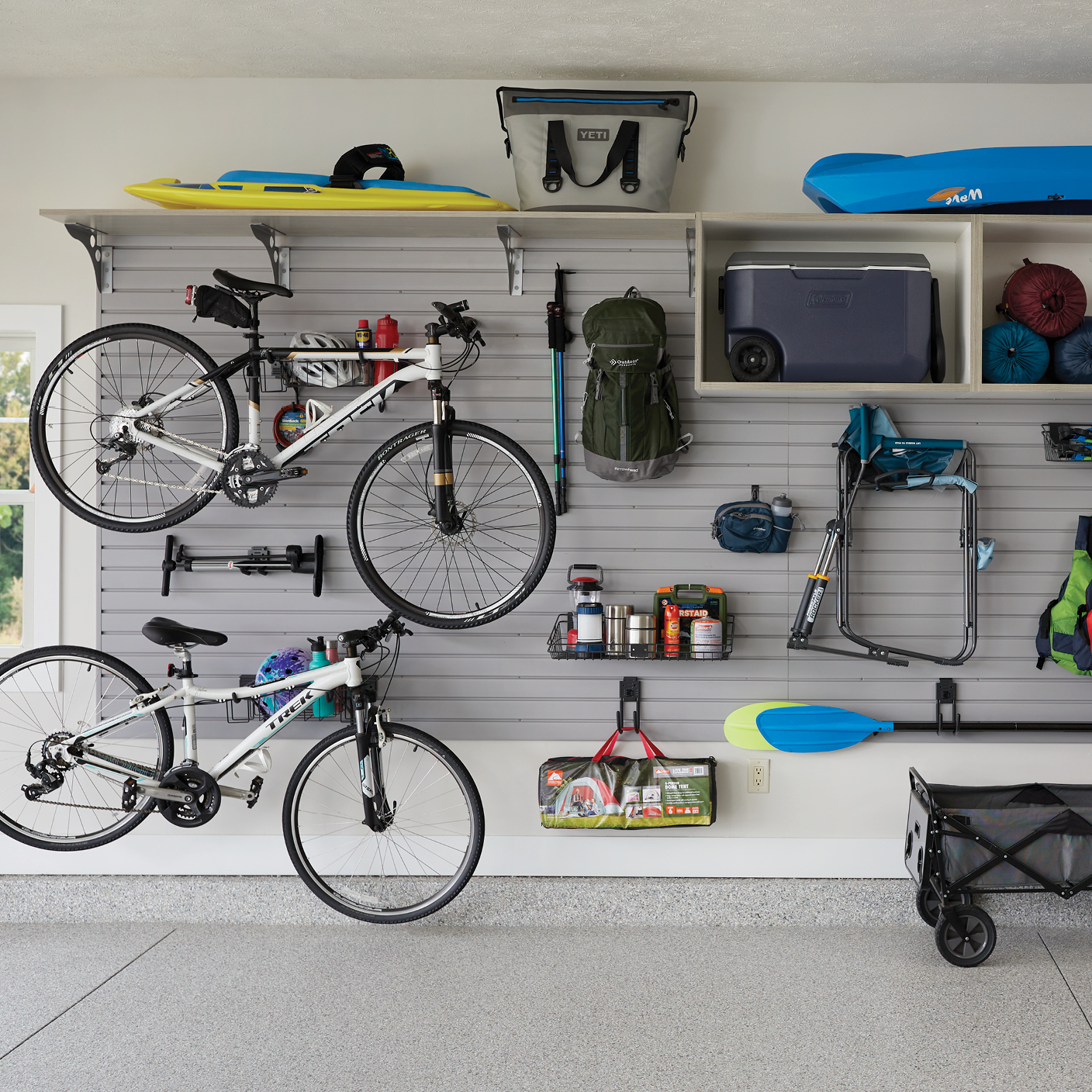 Garage slatwall and cubie storage for sporting equipment by Inspired Closets