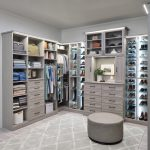 Large custom closet with custom lighting, shelving and adjustable shoe shelves in timber grey