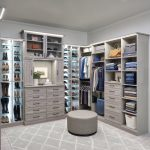 Large custom closet with custom lighting, drawers and adjustable shoe shelves in timber grey