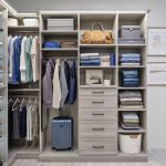 Custom boutique closet in timber grey with integrated lighting, shelves and hanging cloths