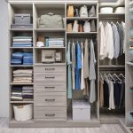 Custom boutique closet in timber grey with integrated lighting and drawers