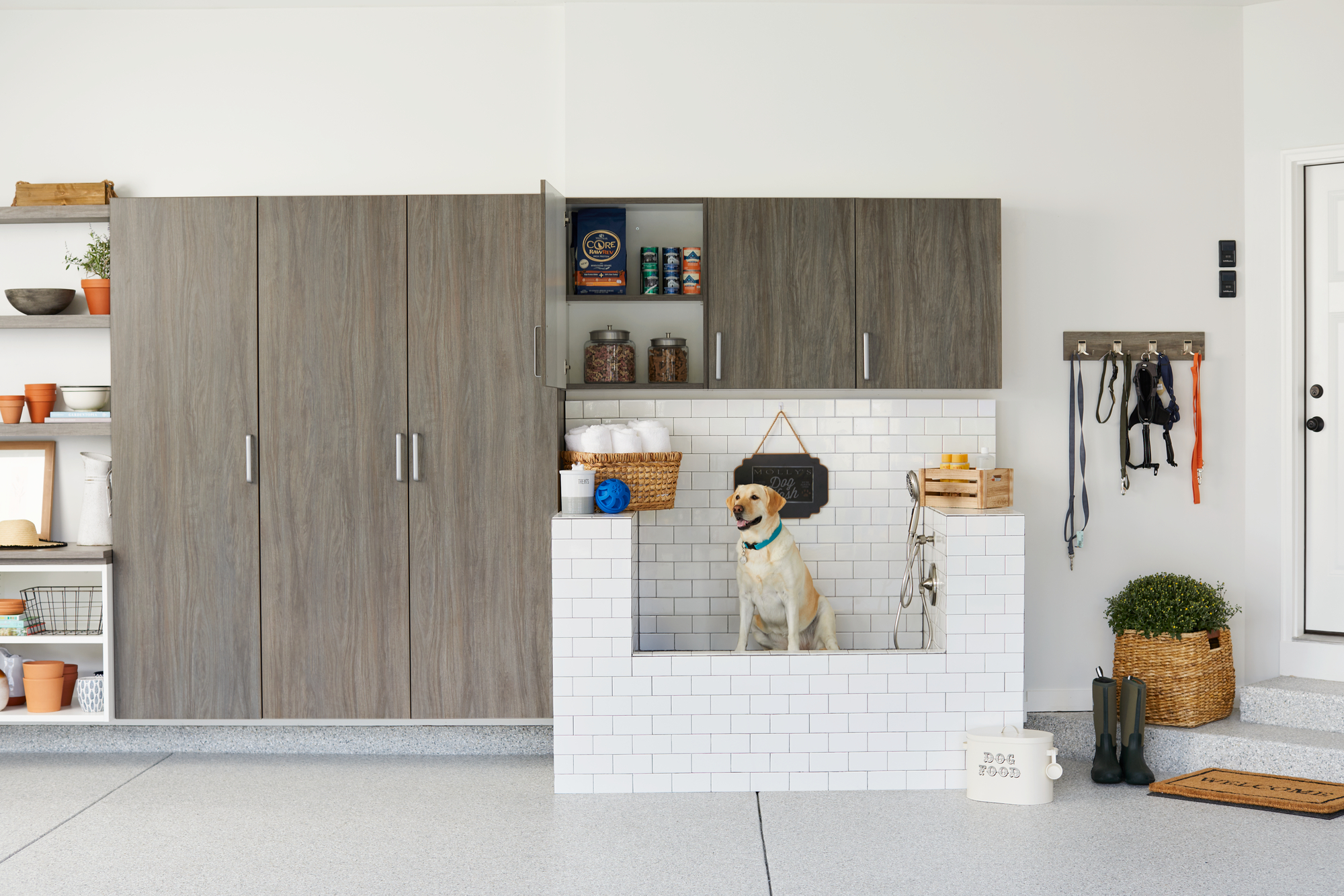 Garage entryway with dog bath from Inspired Closets