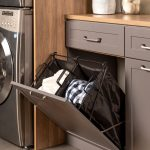 Tilt out hamper for a laundry room mudroom combo from Inspired Closets