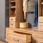Pulled out storage drawers from an Inspired Closets entryway system
