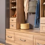 Laundry room and mudroom shared space with pullout drawer storage from Inspired Closets